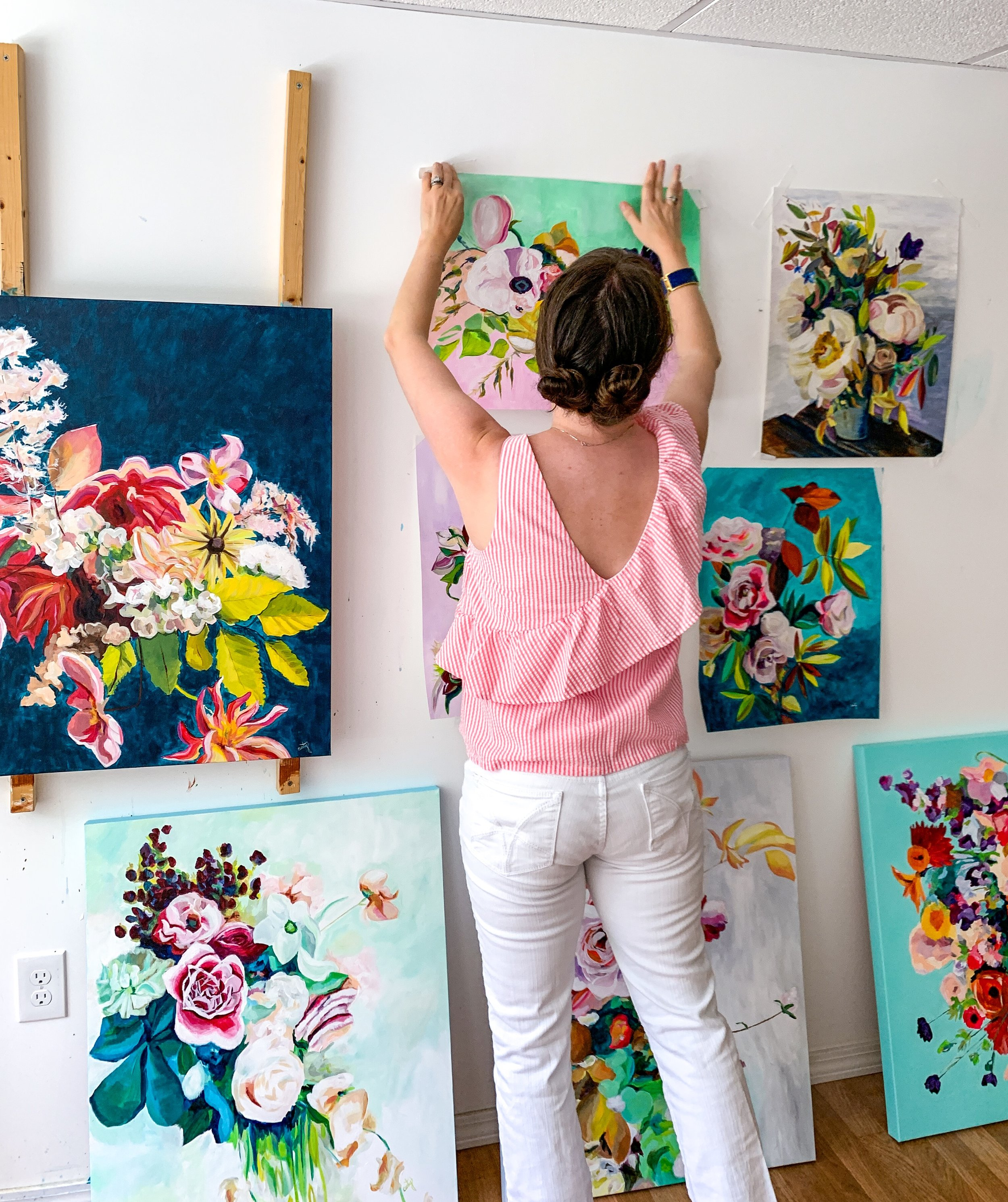 floral paintings by Megan Carty in the studio
