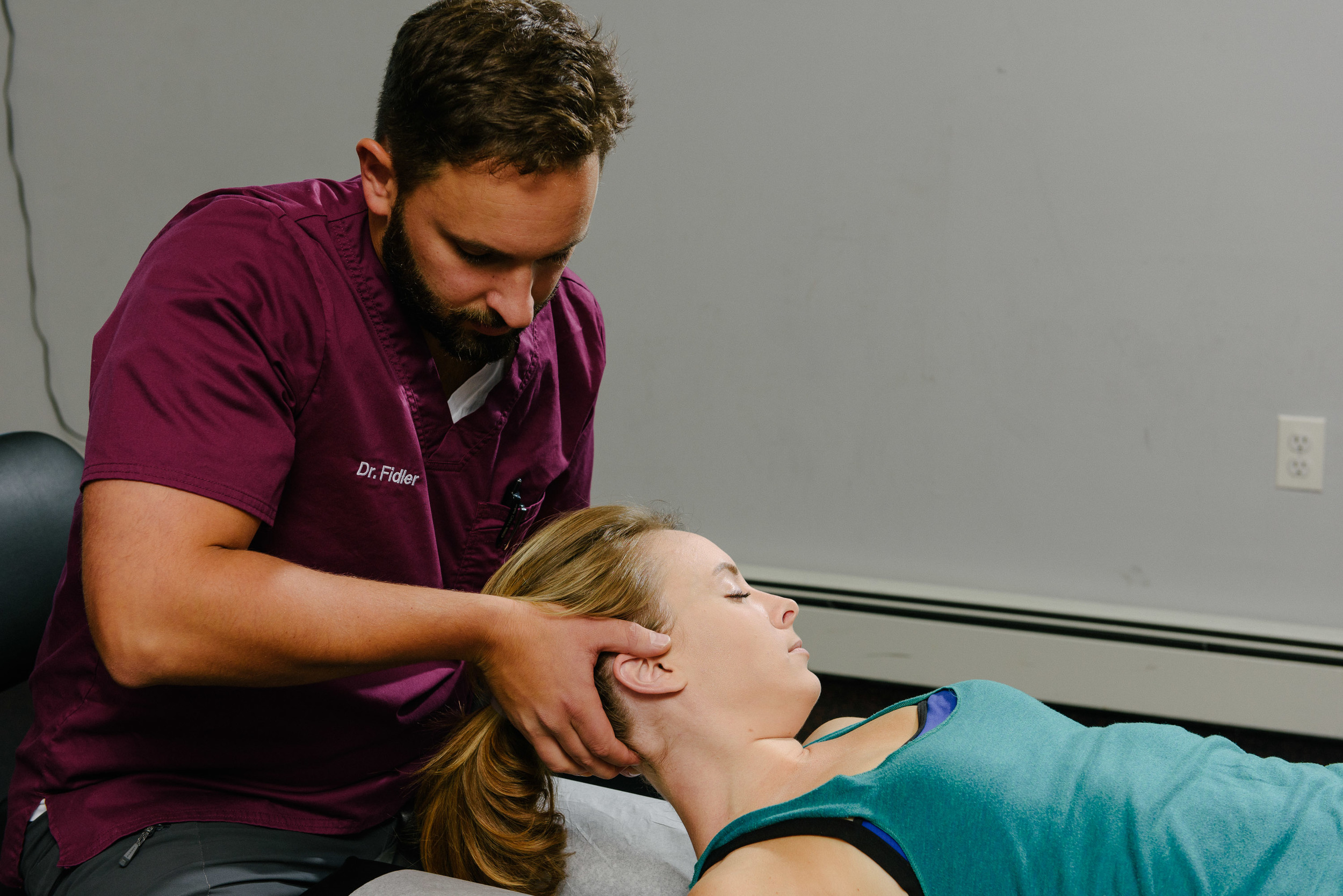 Dr. Fidler treats neck pain at Functional Rehab