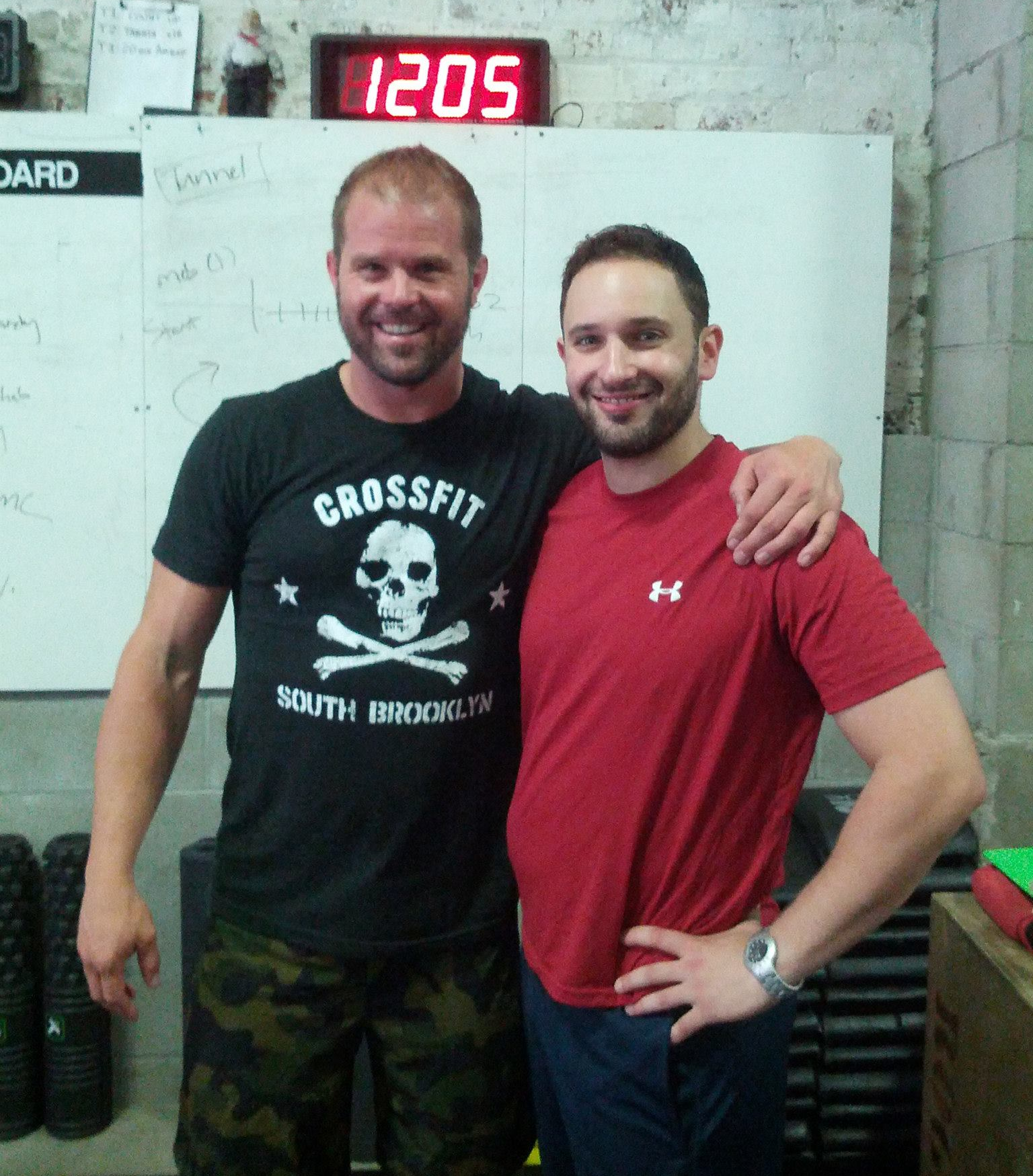 Dr. Fidler working with Dr. Kelly Starrett to teach proper biomechanics and mobility protocols.