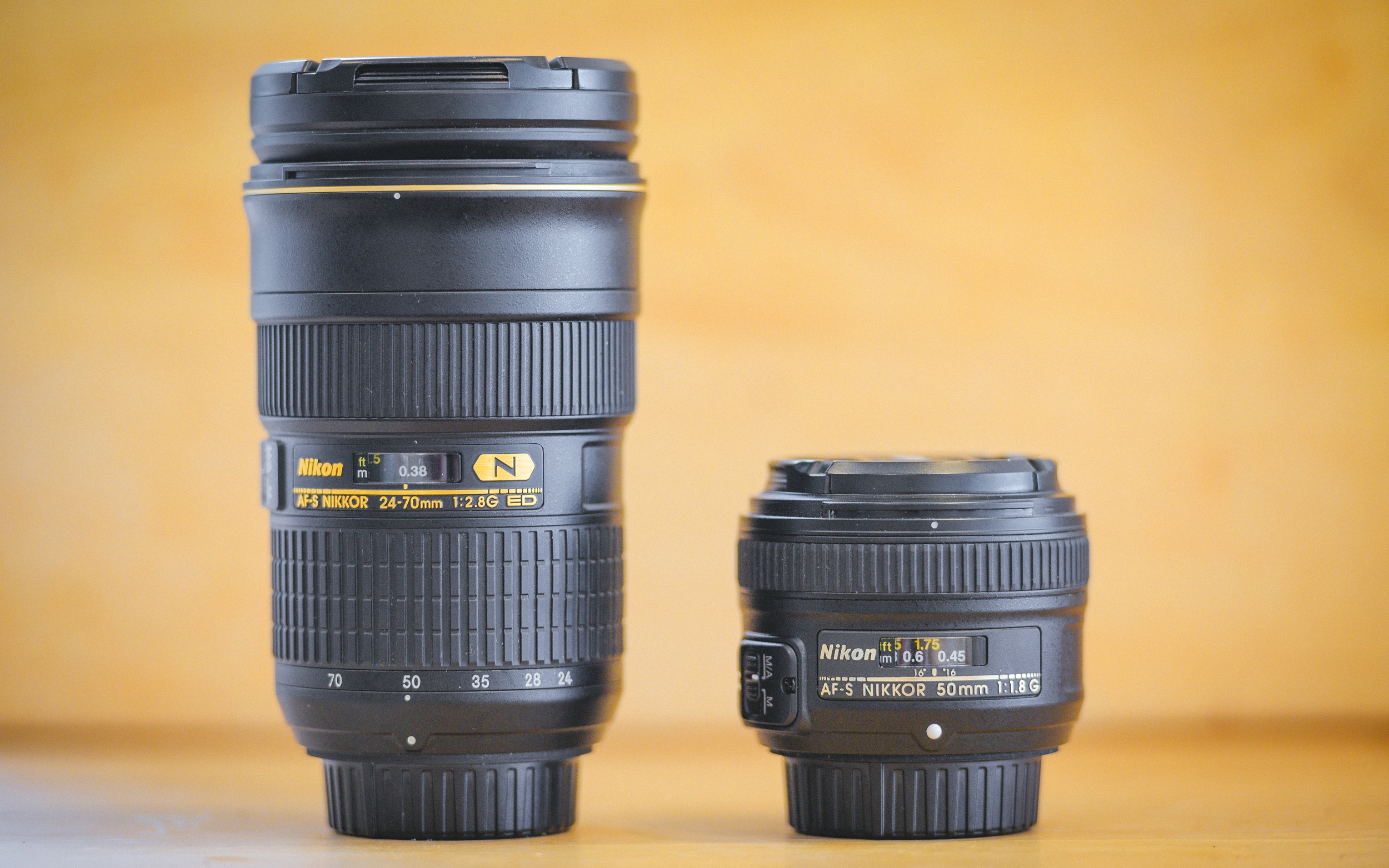 The lens on the left is the Nikon AF-S 24-70mm f/2.8 G ED, a constant aperture zoom lens aimed at Nikon's professional customers, the lens on the right is the Nikon AF-S 50mm f/1.8 G, a prime lens aimed at people looking for a cheap standard prime with full-frame coverage.