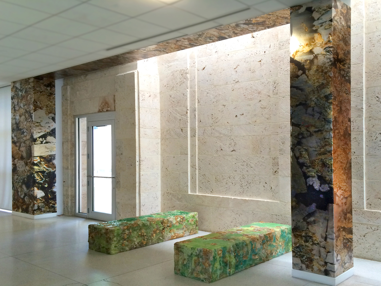 Installation view of Limestone Bearing Gold Veins at The Bass Museum of Art. Metallic wallcovering and handmade benches by Cristina Lei Rodriguez.