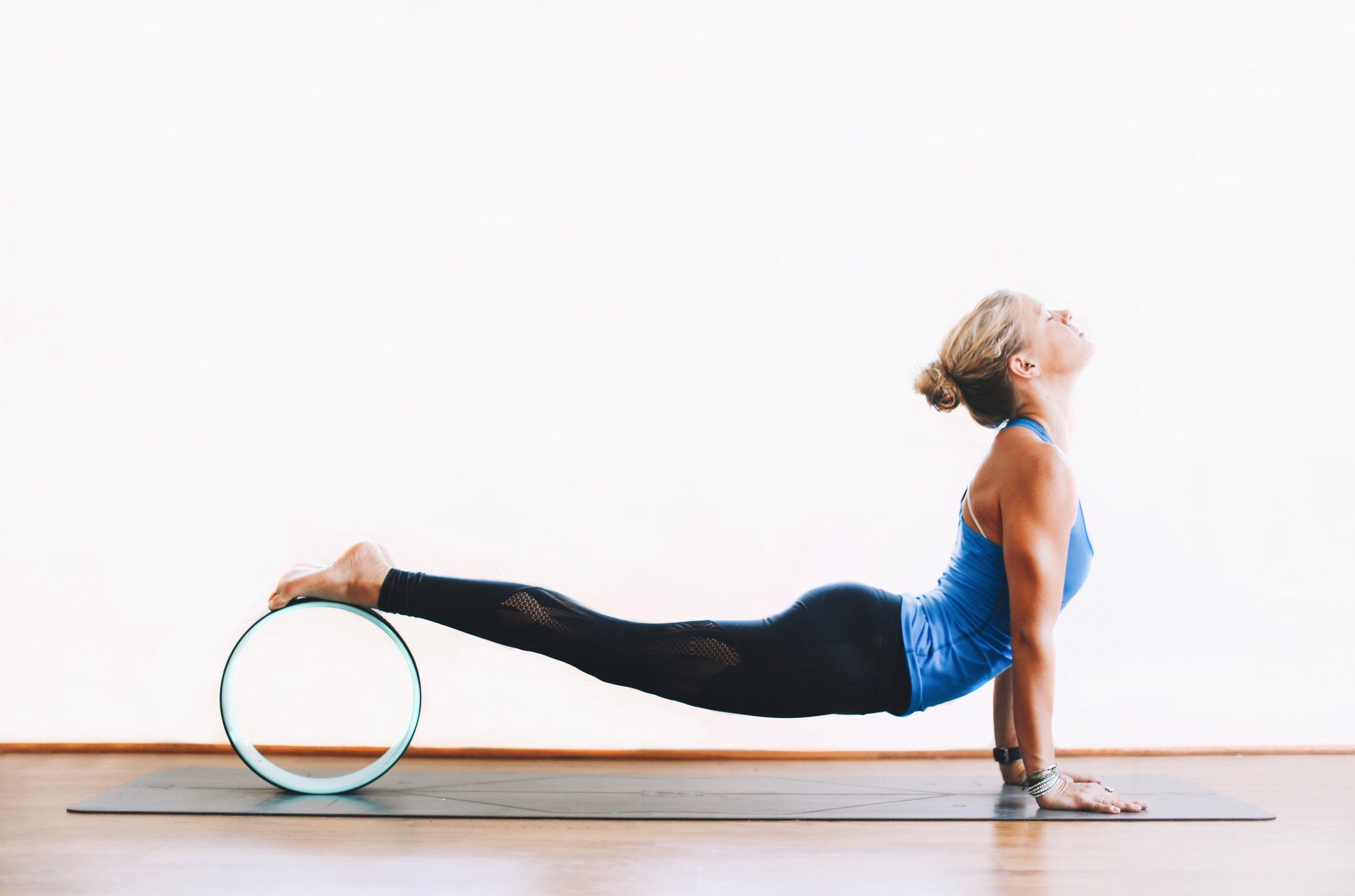 Lindley Battle doing yoga with yoga wheel: Photo by Lindley Battle