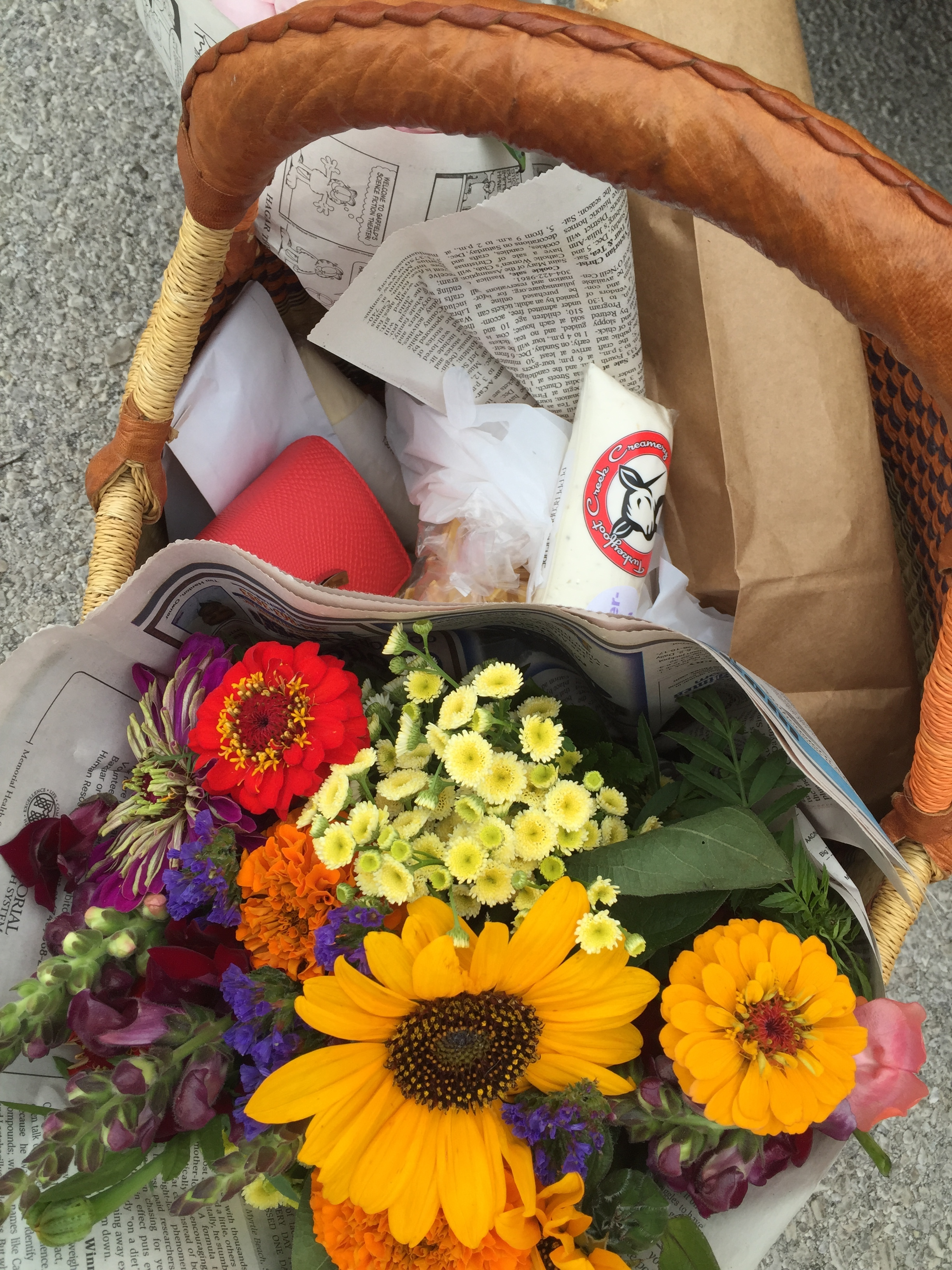 Basket of food and flowers from the Toledo farmers market
