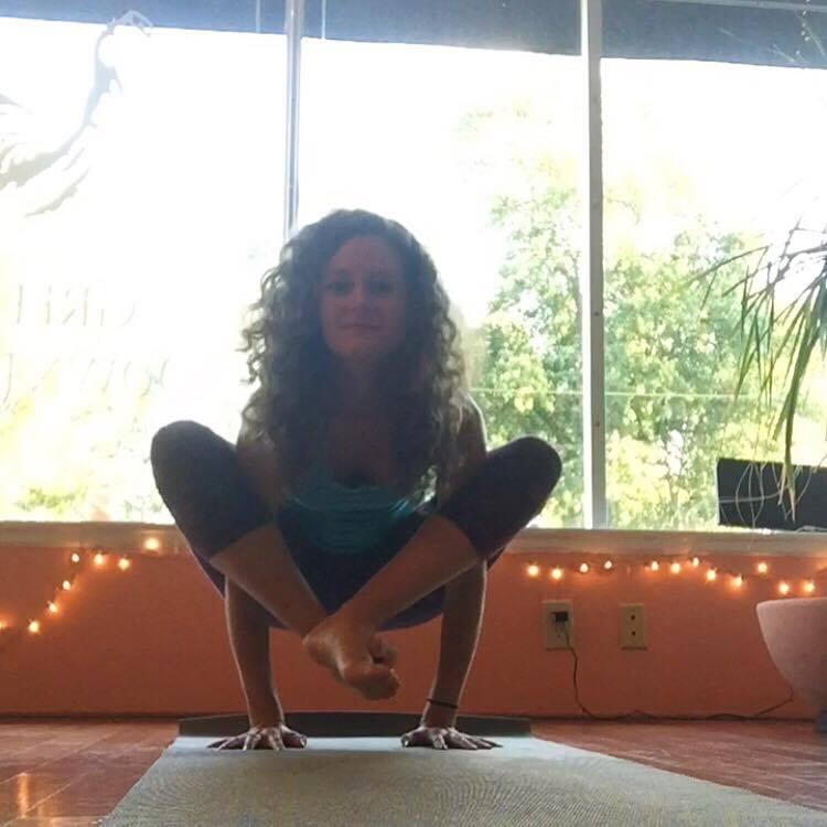 Michaela Coleman doing yoga