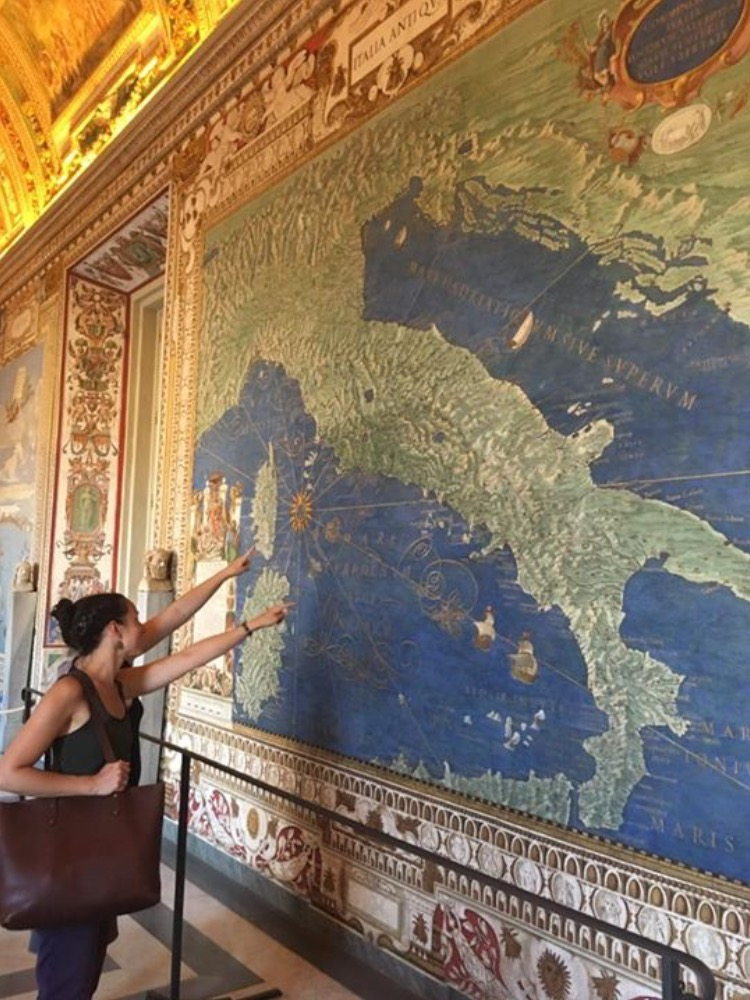 Looking at an old map of Italy at the Vactican and me pointing to Capri