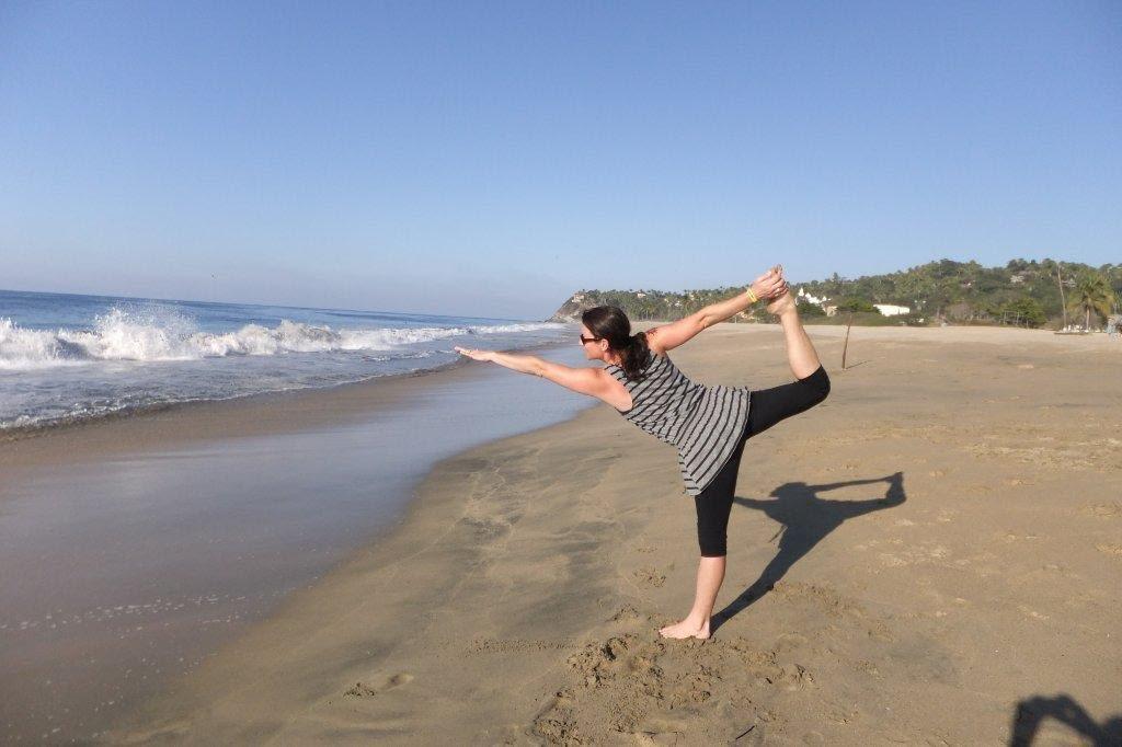 Sara Alvarado in dancer pose on the beach