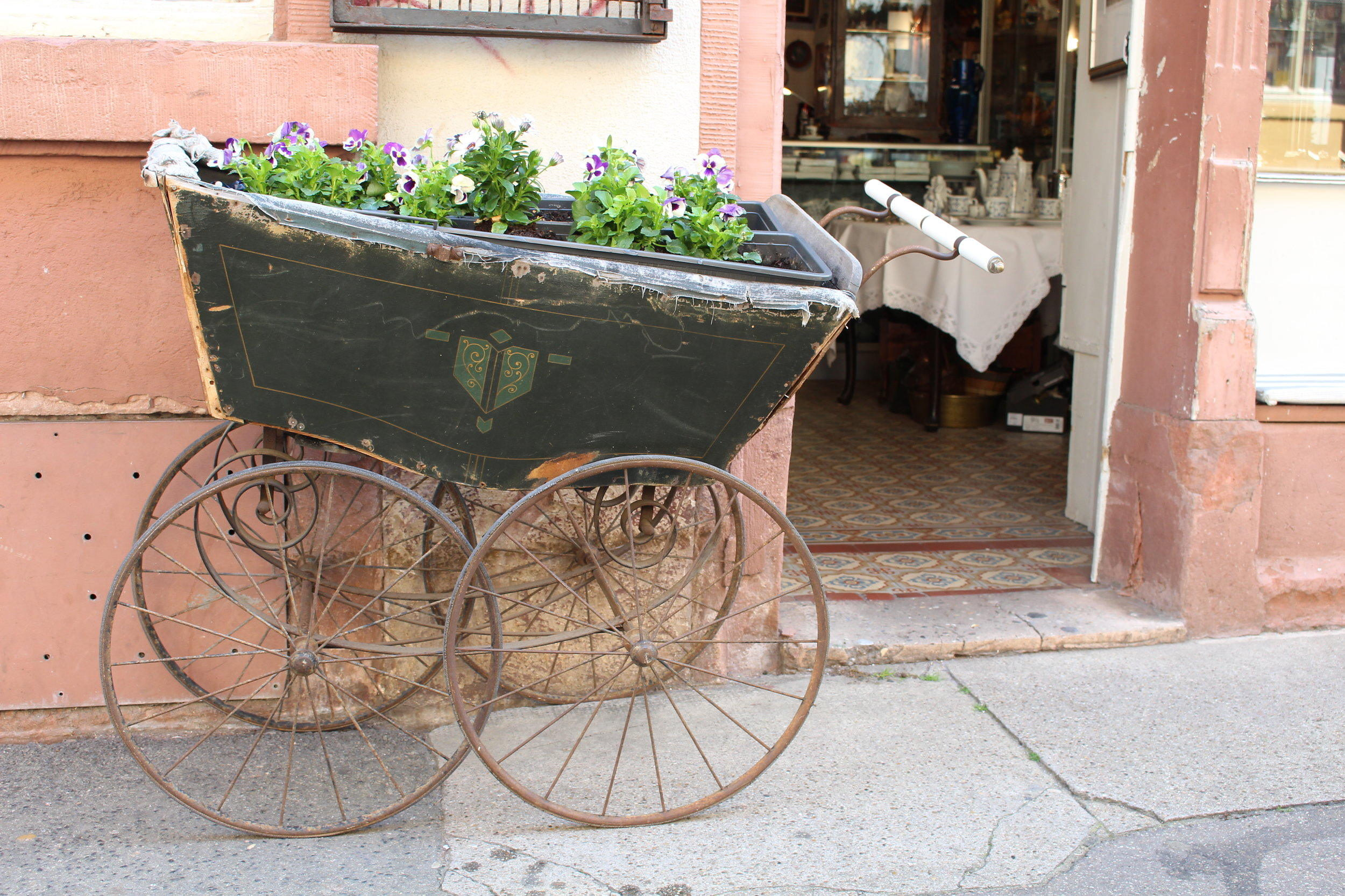 Buggy with flowers in Heidelberg, Germany