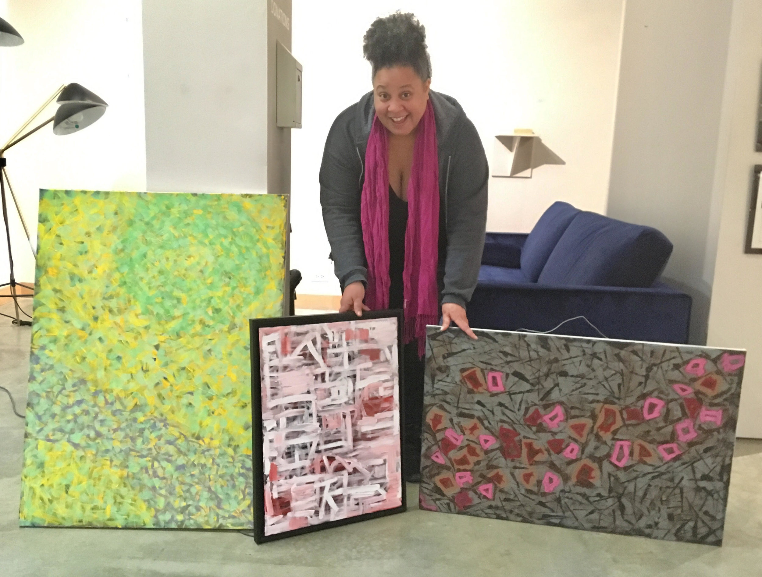 Karen delivering 3 of her pieces of art