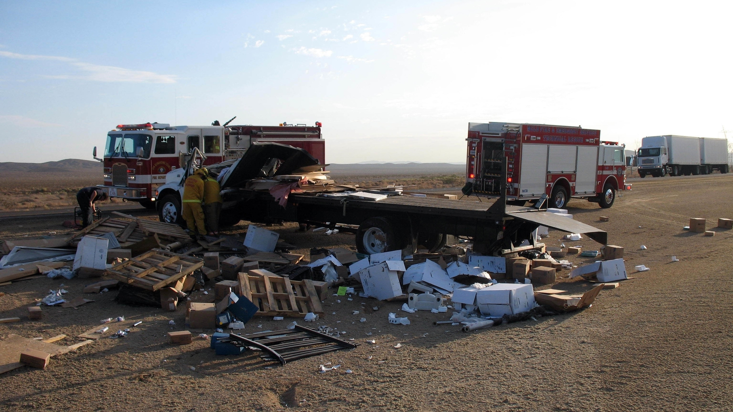 The scene of the accident as rescue workers free Hal from the truck.