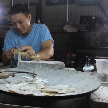 Craftsman at work, Mekong Delta tour.