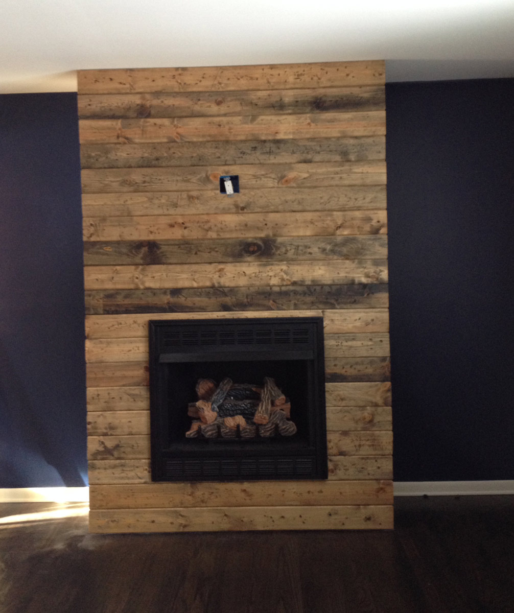 Reclaimed-wood-fireplace-during