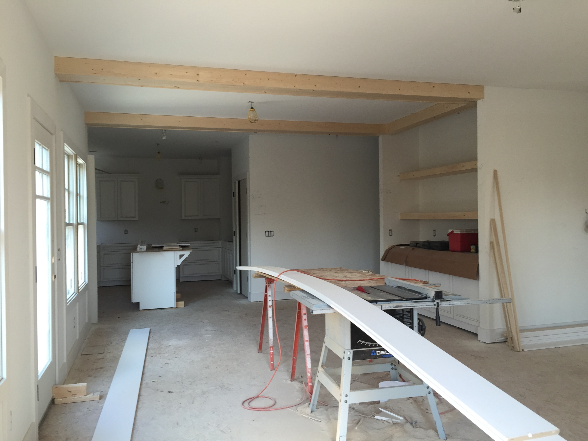 Looking into the dining room and kitchen from the living room. Cabinets being installed!