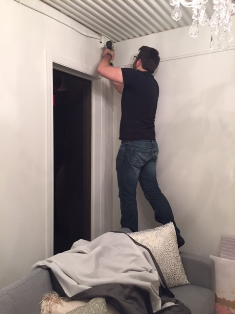 Installing the drapery wall to balance out the wall behind the sofa