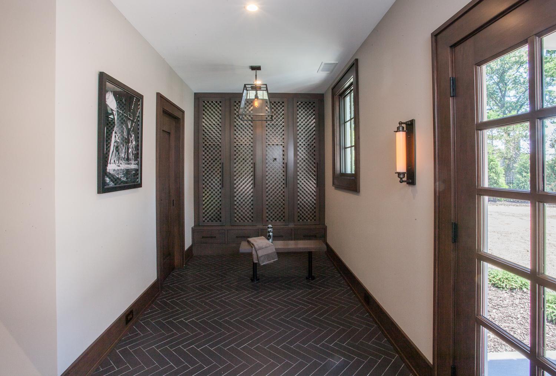 Entry Vestibule Stone Wall - Scott Christopher Homes, Sears Architects, Fuchsia Design