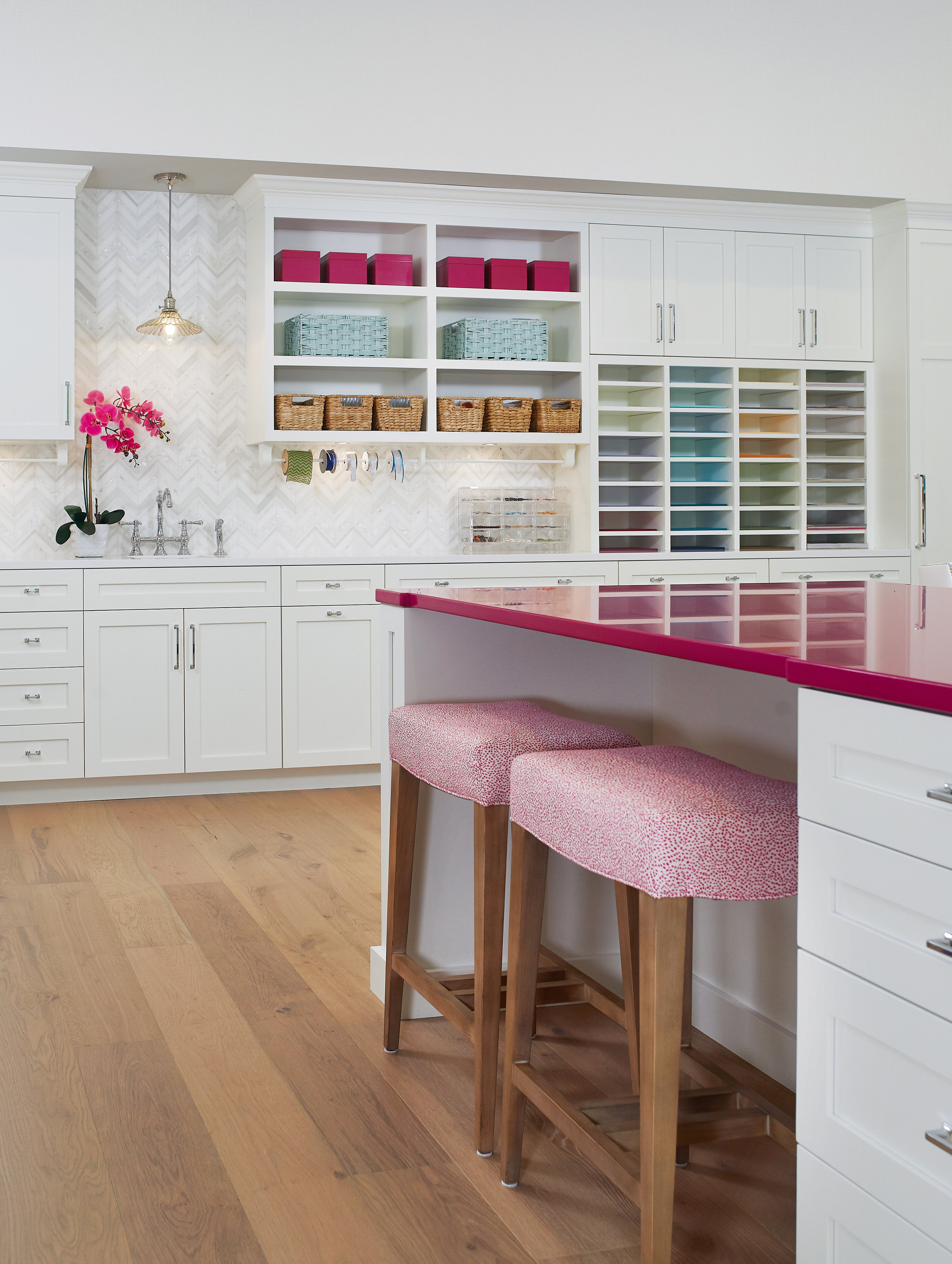 Pink countertop - white cabinetry