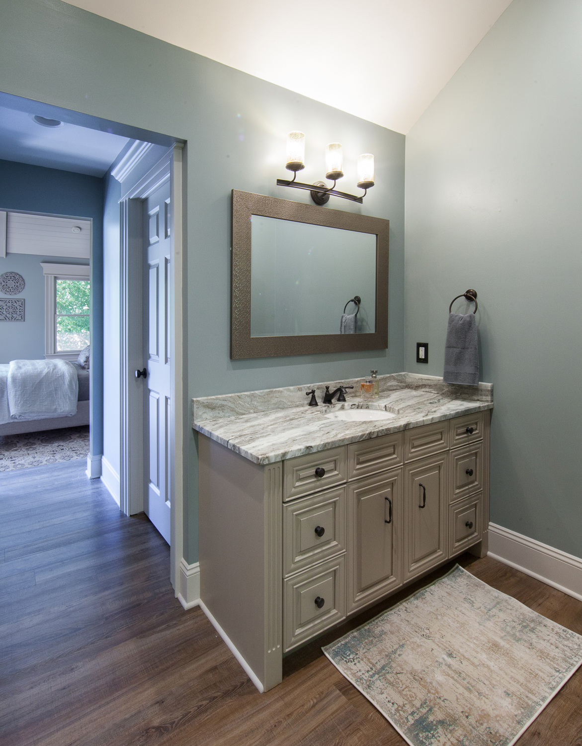 Then, we had the existing bathroom vanities refinished to match the new linen cabinet so both look brand new, and appear as if they were purchased at the same time.