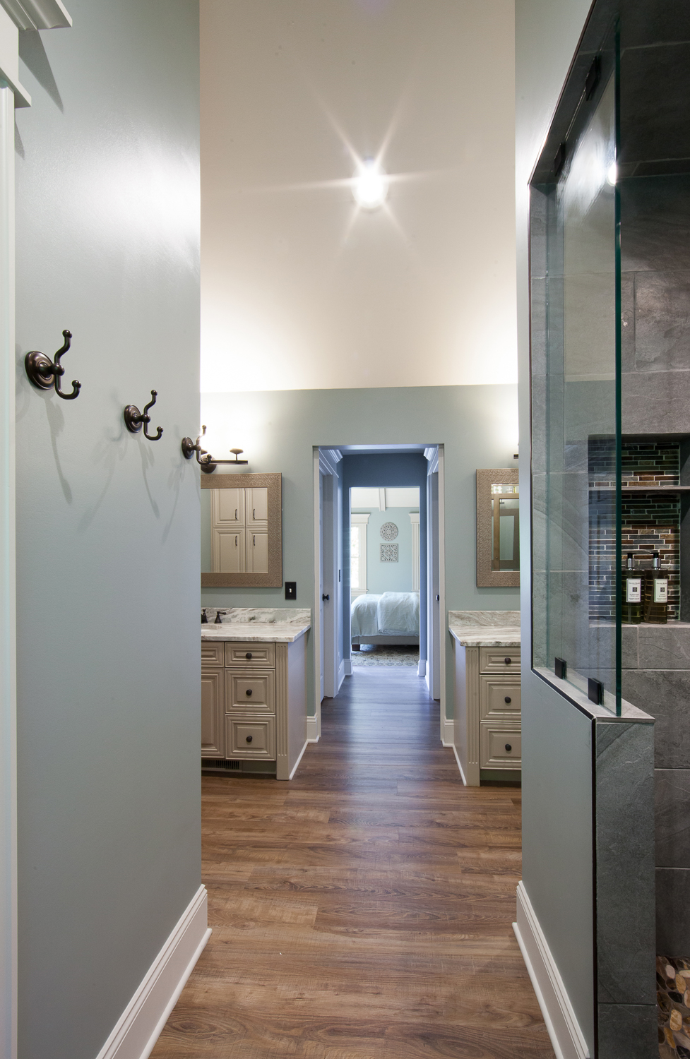 Dual vanities means the husband and wife each get their own side complete with their own private closets in the hallway which leads to the bedroom.