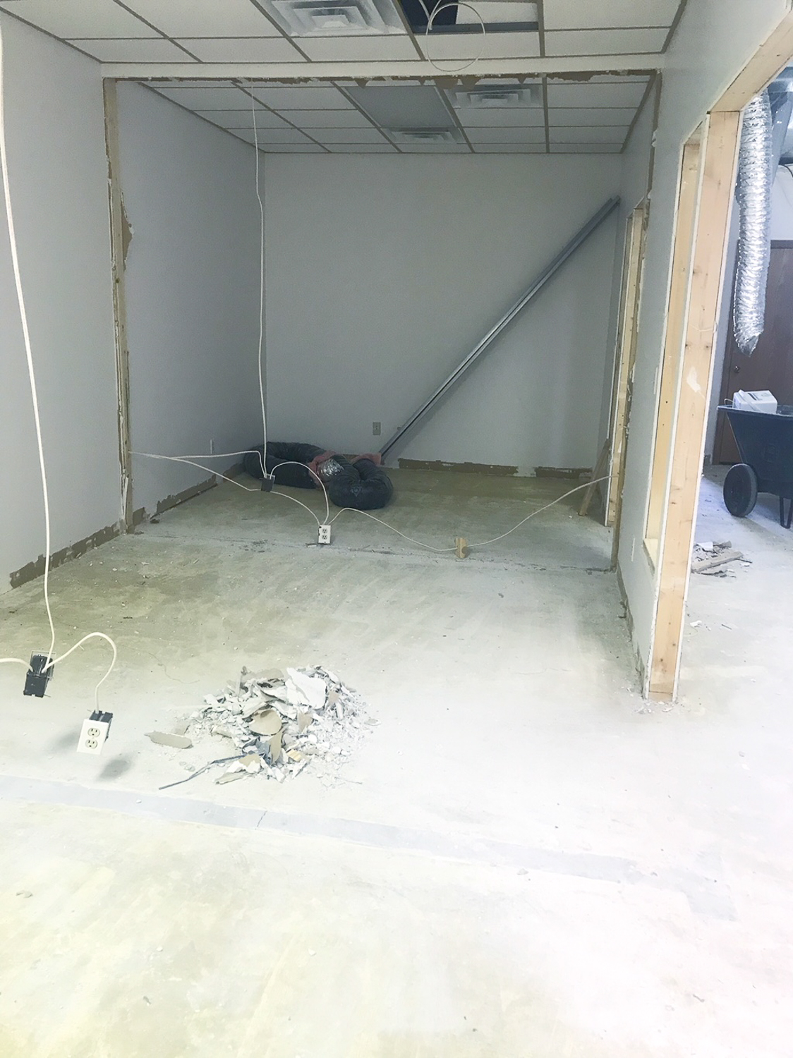 During - walls coming down to make three offices into two