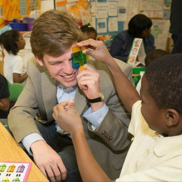 "Matt ""makes green"" with a kindergartner at Atlanta's Cleveland Avenue Elementary School during a visit there in March 2014."