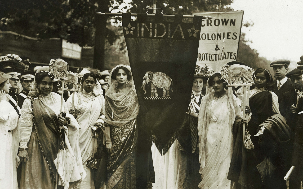 (c) Museum of London. Image shows Indian woman participating in an English Suffragette event.
