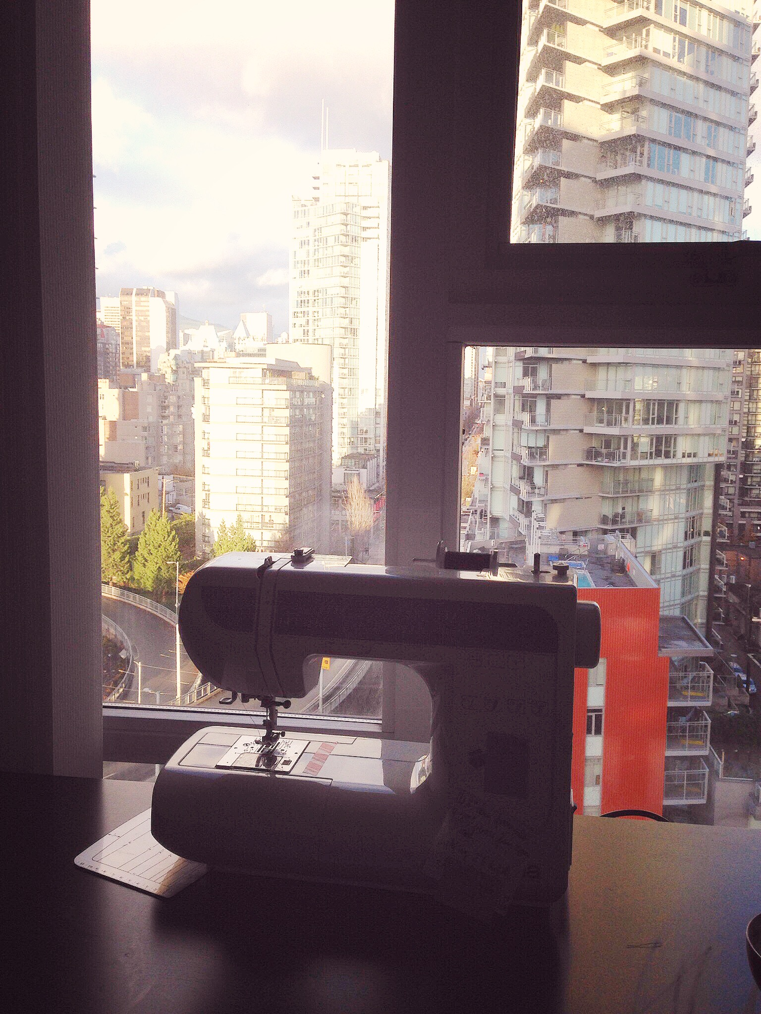 Ethan over looking our sewing window, the best part of the craft room is the natural light that floods in from the long windows and the view of the city and mountains on clear days.