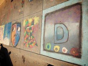 a row of chalk art