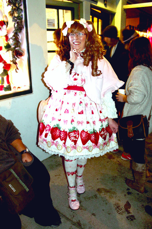 a person wearing a strawberry shortcake costume