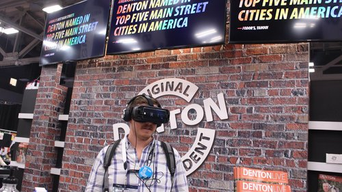 a picture of a person trying out a virtual reality headset