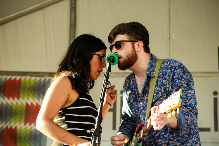two people singing on a stage