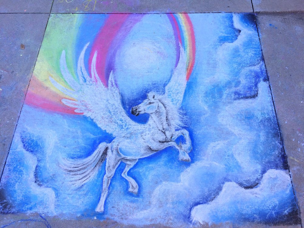 a chalk design of a pegasus in the sky