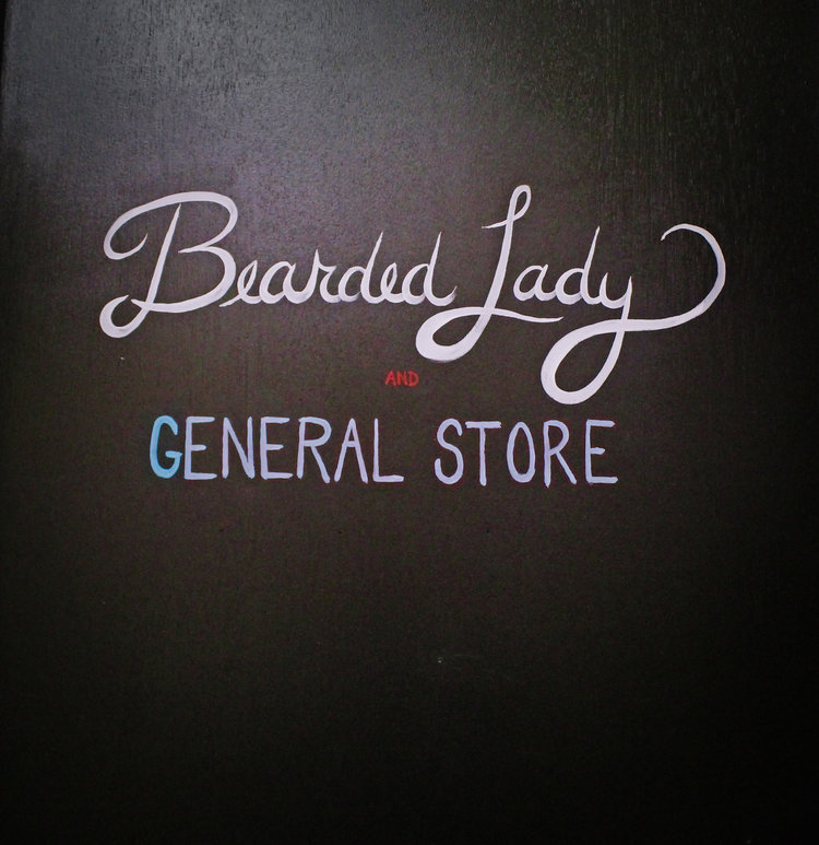 a picture of bearded lady general store sign