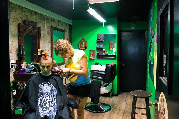 a person getting their hair cut