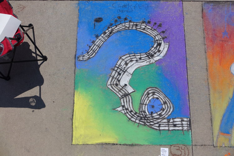 a chalk design of a stave of music.JPG