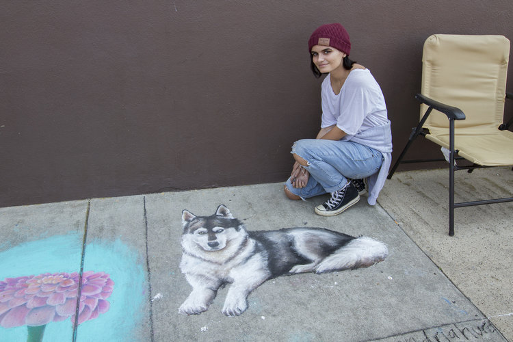 a person posing with their wolf chalk art © Tammi Paul Photography