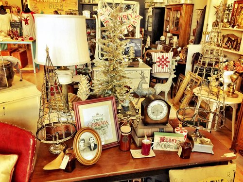 a selection of holiday decorations on display inside a store