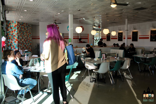 a picture of people inside the spiral diner restauraunt