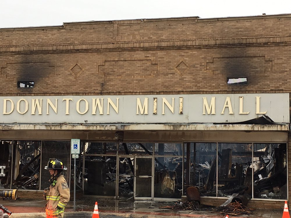 a picture of a damaged storefront that reads downtown mini mall