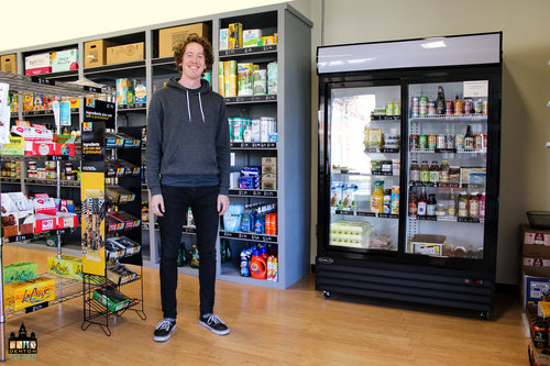 a man standing inside a grocery store