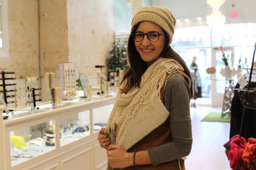 a picture of a person in winter wear posing inside a store