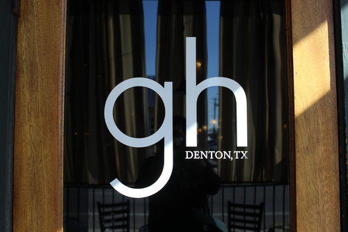 a picture of a door with the greenhouse restaurant logo