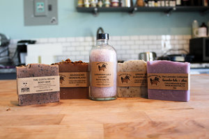 a picture of an assortment of salted sanctuary soap products on a table