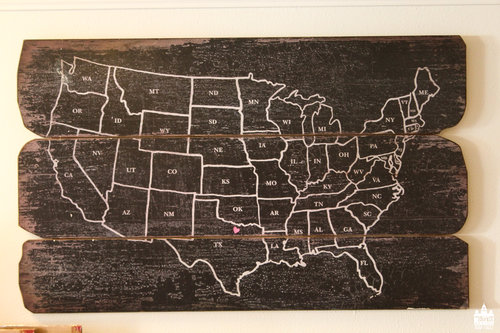a wood pallet with a white map of the united states