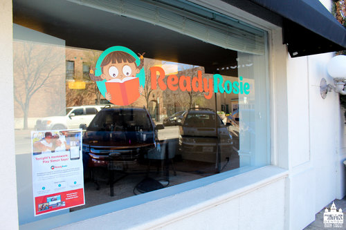 a picture of a business window with a ready rosie logo