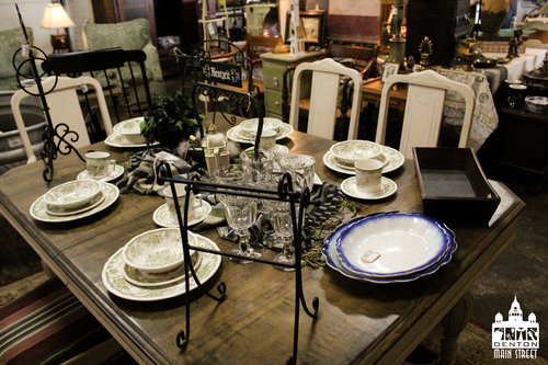 a picture on the inside of the vintage shop with some dining and plate wear