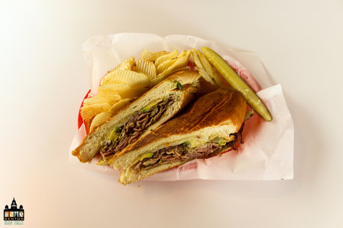 a picture of sandwich and chips