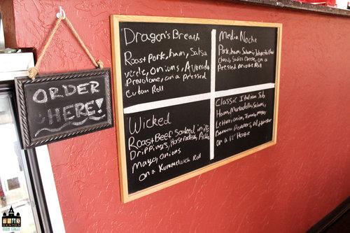 a chalk board menu inside a sandwich shop.jpg