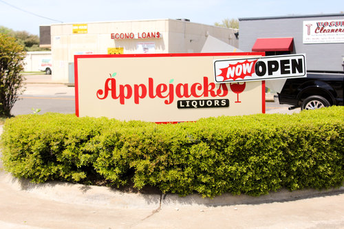 a picture of an outdoor sign for applejacks liquor