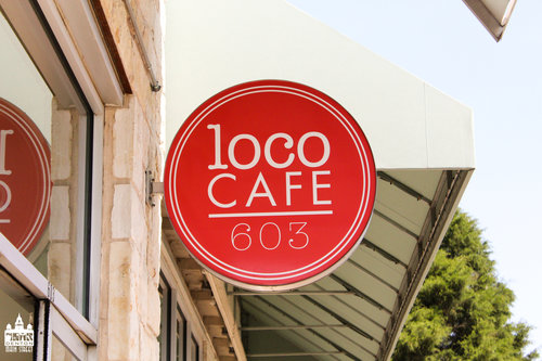 a picture of the outdoor loco cafe sign