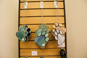 a picture of wind chime dog feet