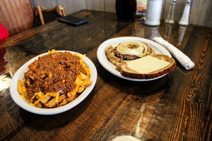 a picture of chili cheese fries and a sandwich